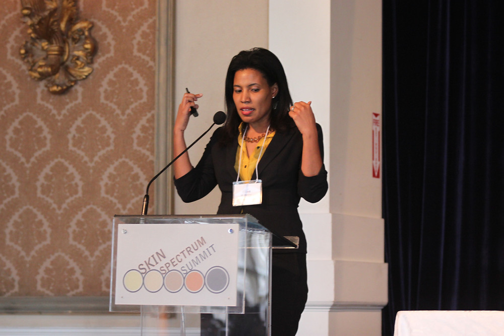 Dermatologist Dr. Heather Woolery-Lloyd speaking at the Skin Spectrum Summit in Toronto