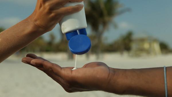 Sunscreen application. Photo courtesy of AAD