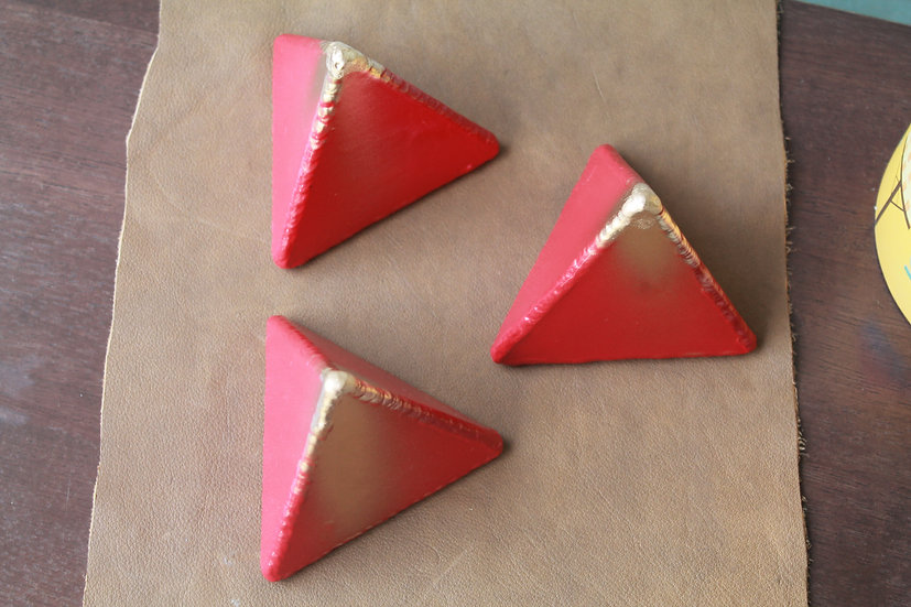 Small red tetrahedron metal art