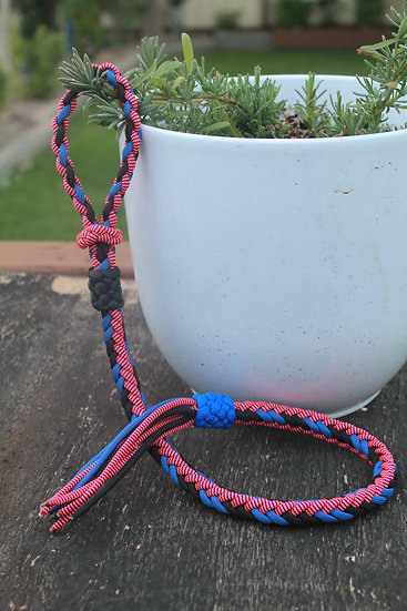 Braided barrel racer quirt in pink, black and blue