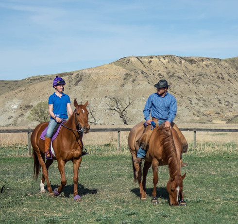 Bob and Sarah riding their mares in handmade braided paracord roping reins and neck strap.