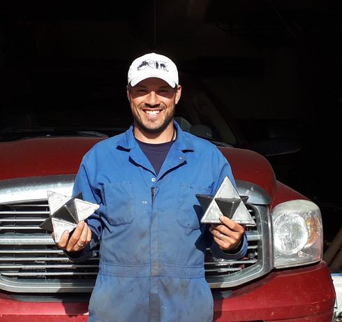 Bob holding two hand welded merkabahs, sacred geometry home decor.jpg