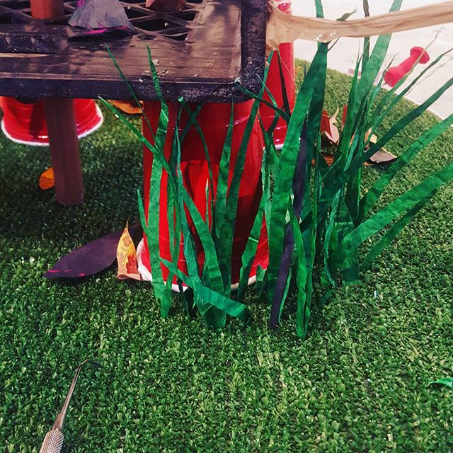 Studio nuggets... inserting single blades of fake grass into fake grass..