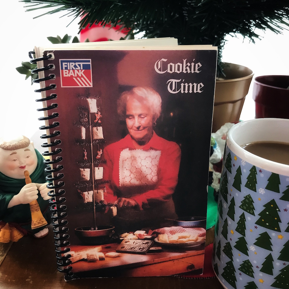 cookie booklet with cover of an white-haired woman in red dress putting German cookies on a Christmas tree.
