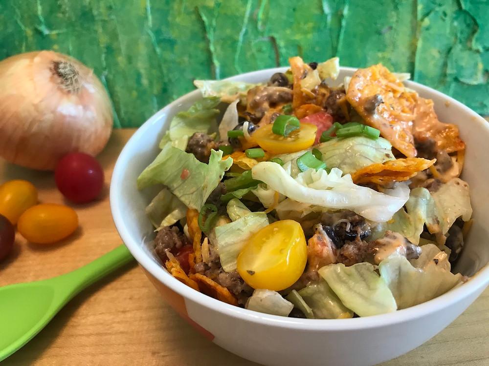 taco salad in white bowl