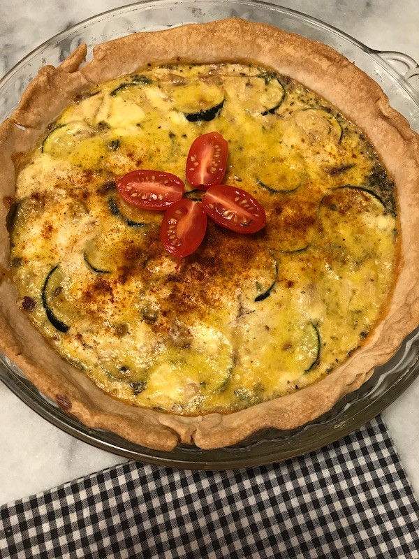 zucchini pie with tomato garnish
