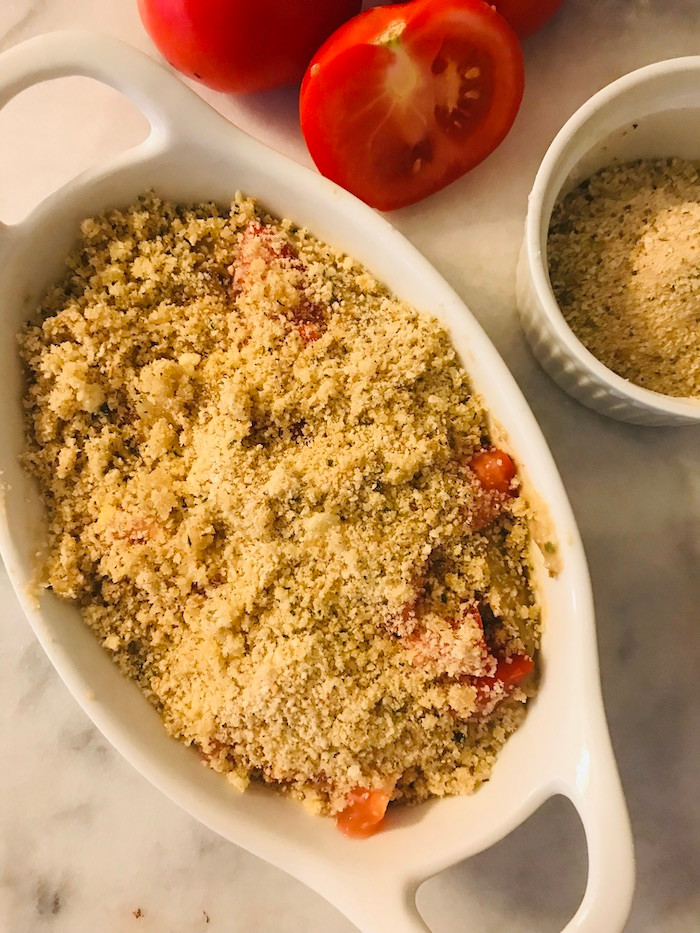 eggplant dip in a casserole with tomatoes