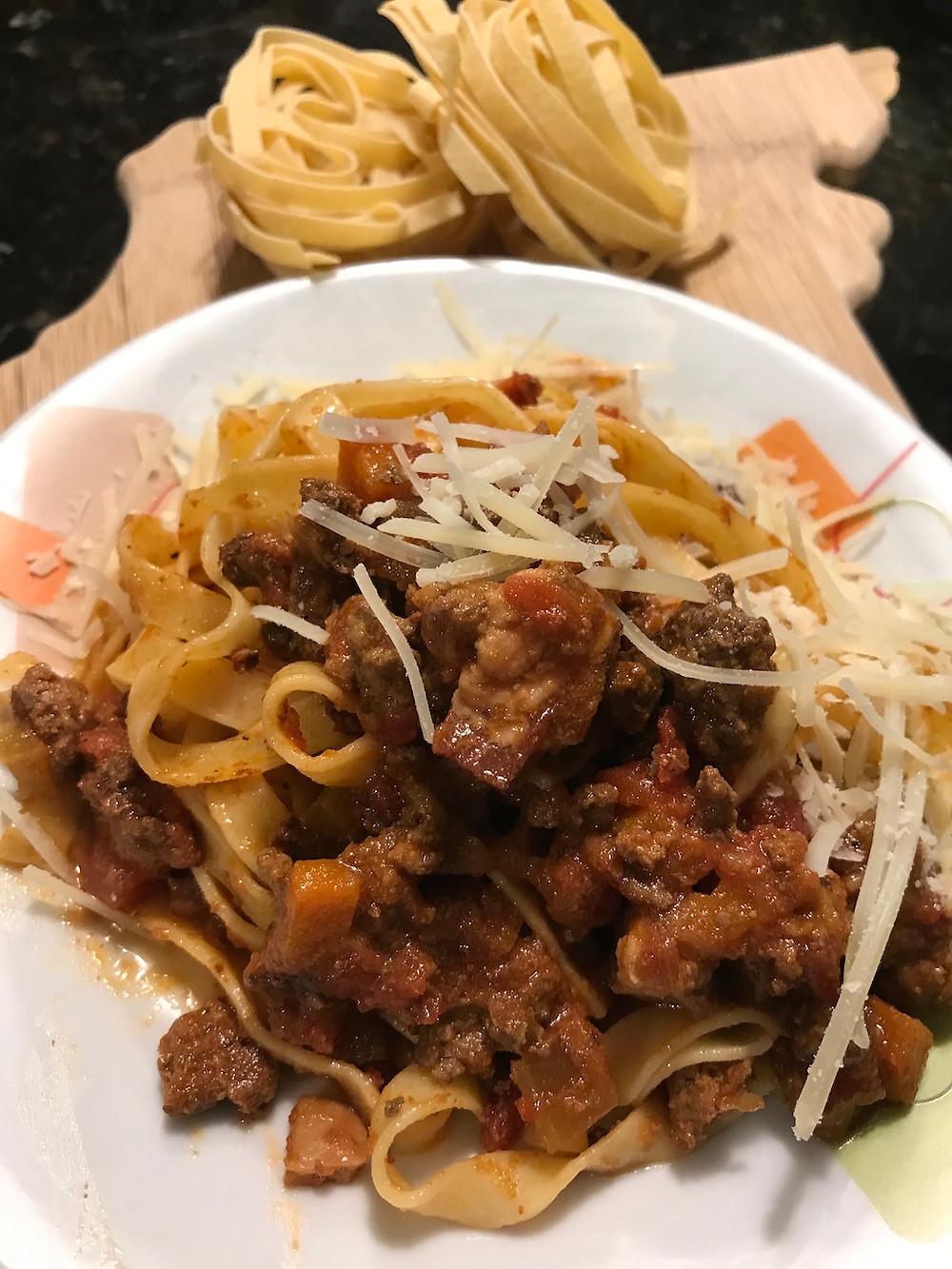 Bolognese sauce over tagliatelle pasta