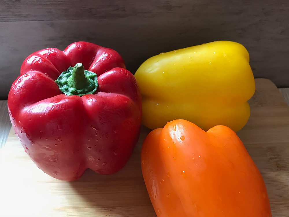 red, orange and yellow bell peppers