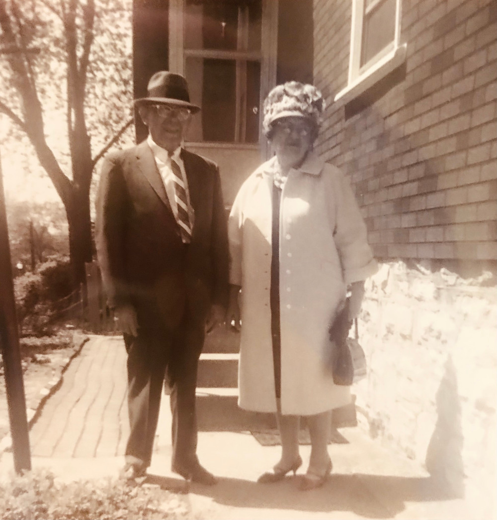 Elderly man and woman dressed for church.