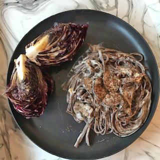 chocolate pasta with mushrooms in gorgonzola sauce