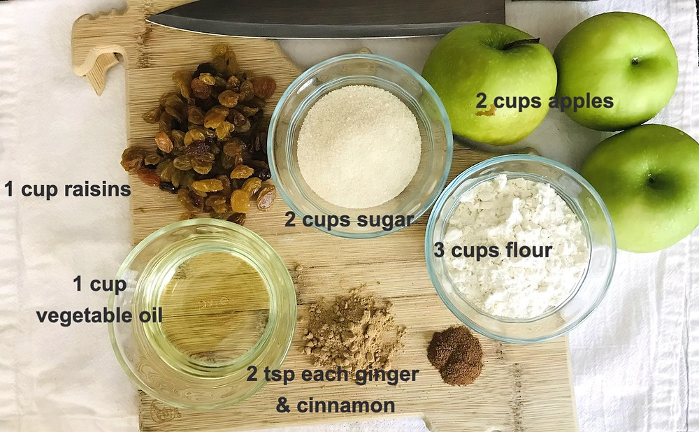 oil, raisins, sugar, apples, flour, ginger and cinnamon on kitchen counter
