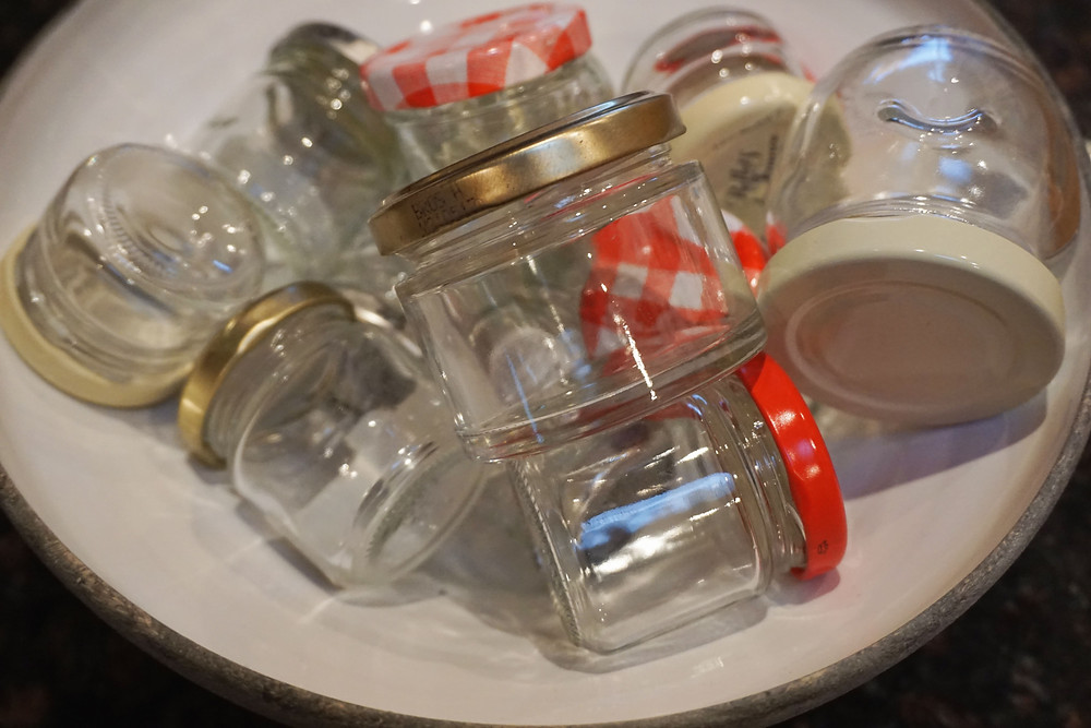 Old glass jars that can be reused as scrub containers