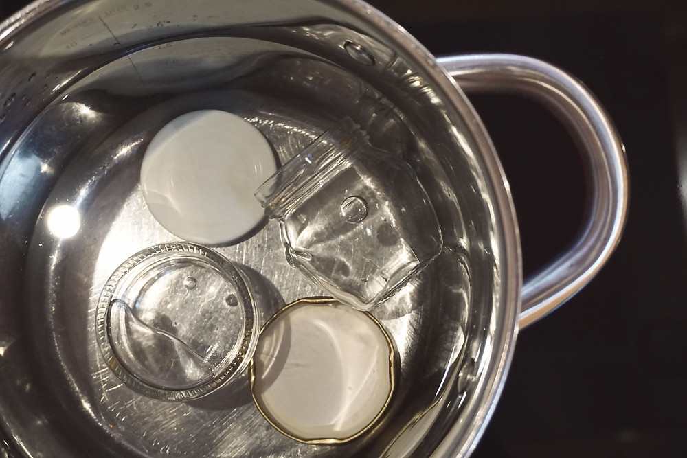 Jars being sterilized in boiling water