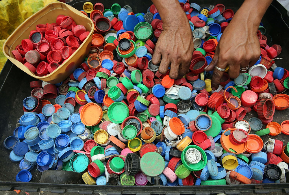 Plastic caps are sorted for recycling