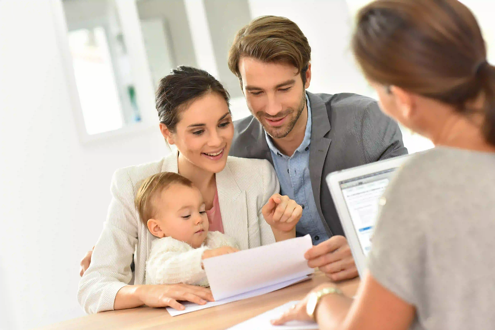 Family signing tenancy agreement with estate agents in Birmingham