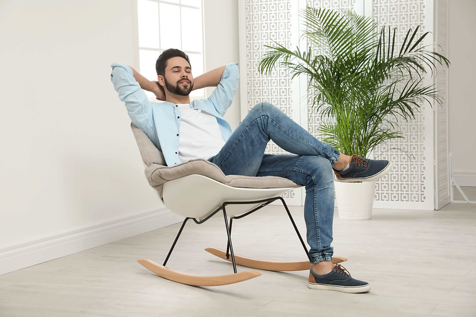 Relaxed landlord sitting in a rocking chair