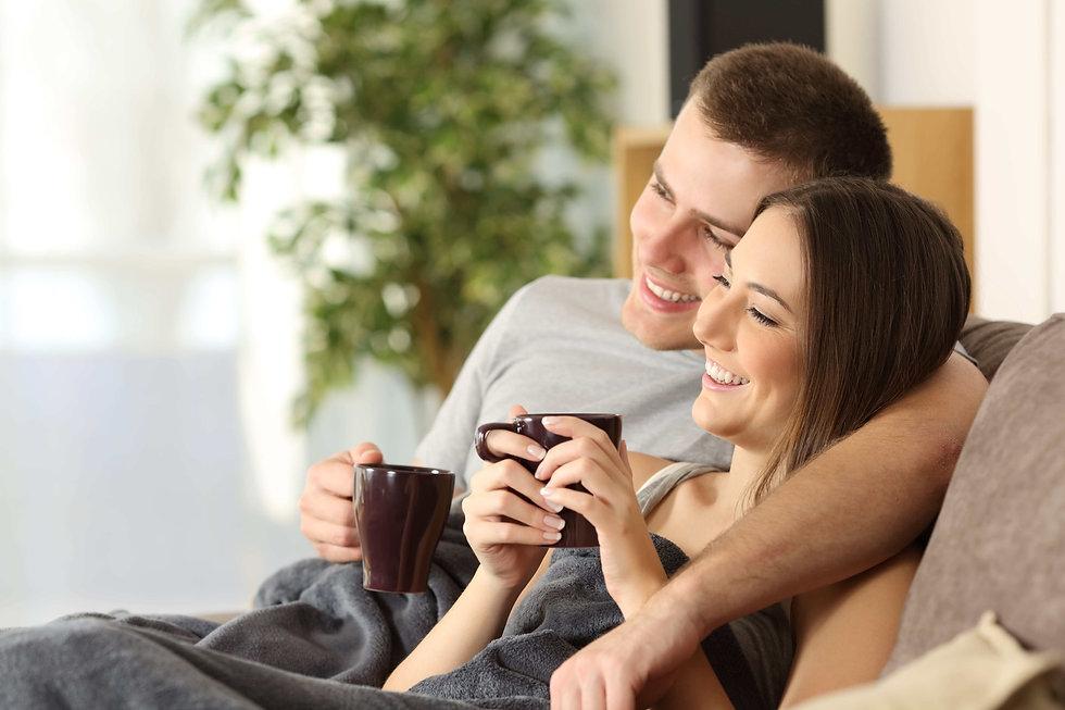 Tenants enjoying a hot drink in their new property in Birmingham