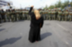 Uyghur woman in confrontation with the Chinese security forces during 2009 Xinjiang Uprising. (Photo: BBC)
