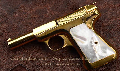 Gold Savage Model 1917 pistol with pearl grips