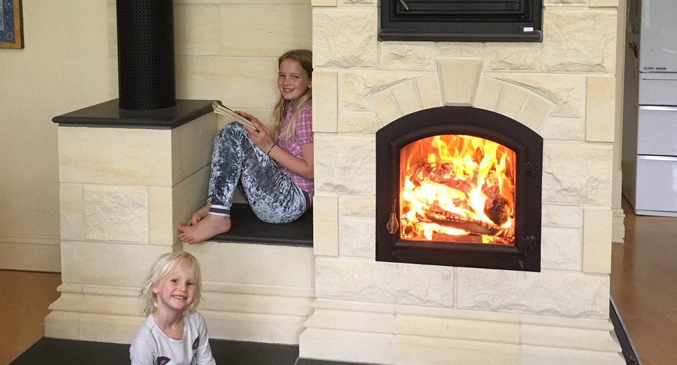 Stone, single door with oven and Flue - Heavenly Heat Masonry Heaters.jpeg