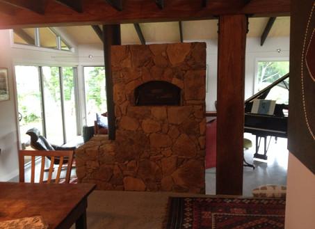 Stone - double sided single door with oven at back -  Heavenly Heat Masonry Heaters.JPG