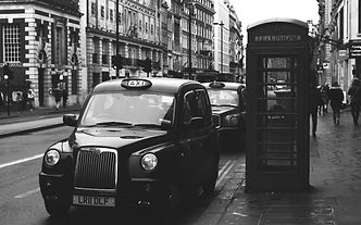 black%20Taxi%20beside%20telephone%20boot