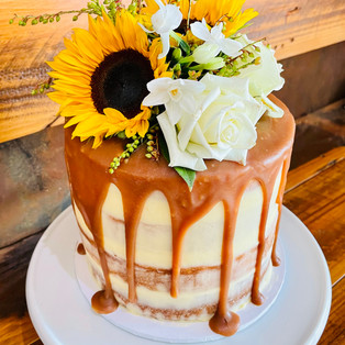 Naked Caramel Mud Cake w florals & caramel drip.jpg