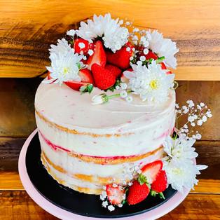 Classic Sponge w house made jam, cream, fresh strawberries & florals.jpg