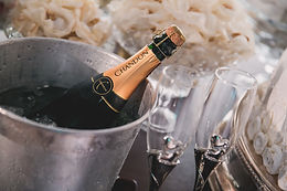 Champagne in ice bucket at luxury wedding venue.