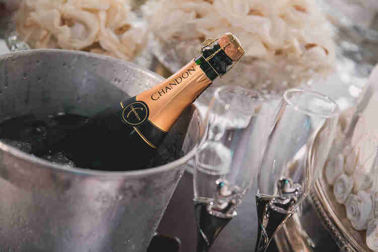 bottle of champagne chilling in a silver ice bucket