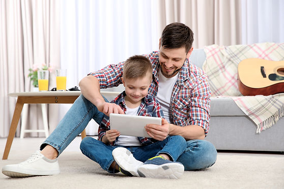 Father and his son with tablet computer