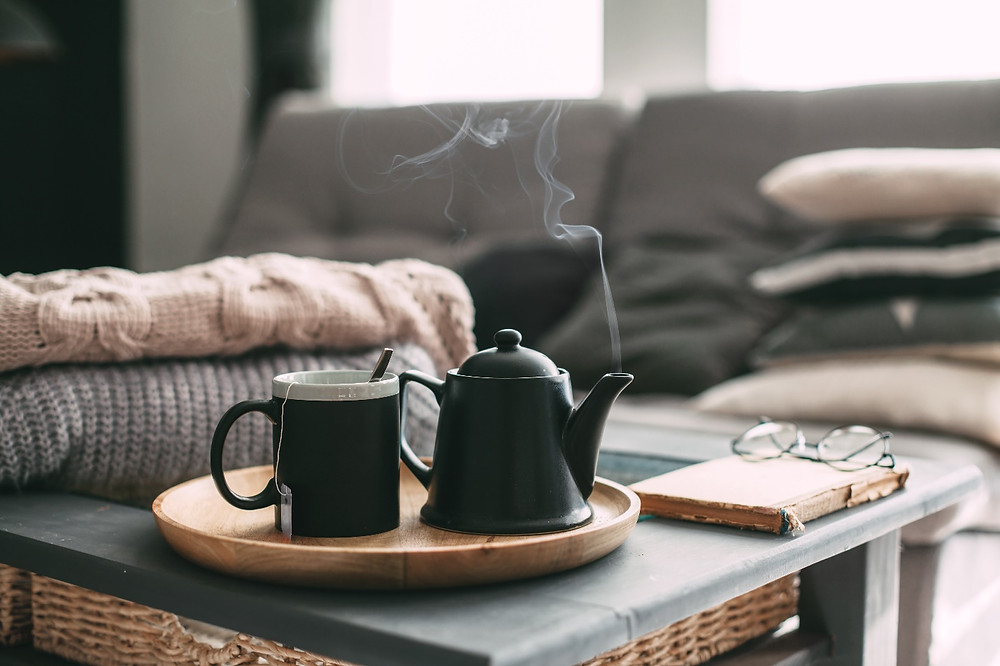 tea pot, cup and book on side-table