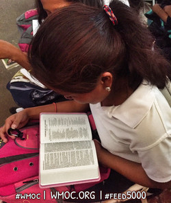 Reading her Bible during WMO Chapel