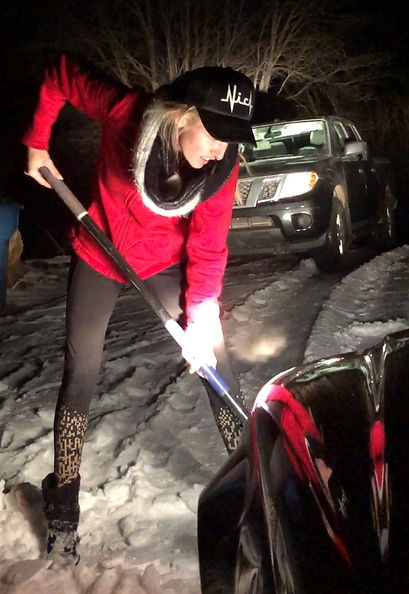 Shoveling car out of snow