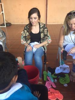 Mary washing Norwins feet