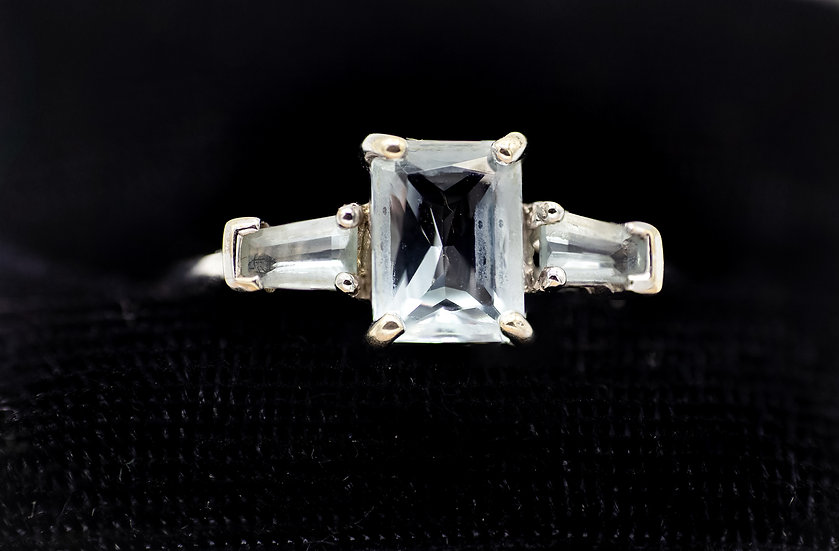 9ct White Gold and Pale Blue Topaz Trilogy Ring