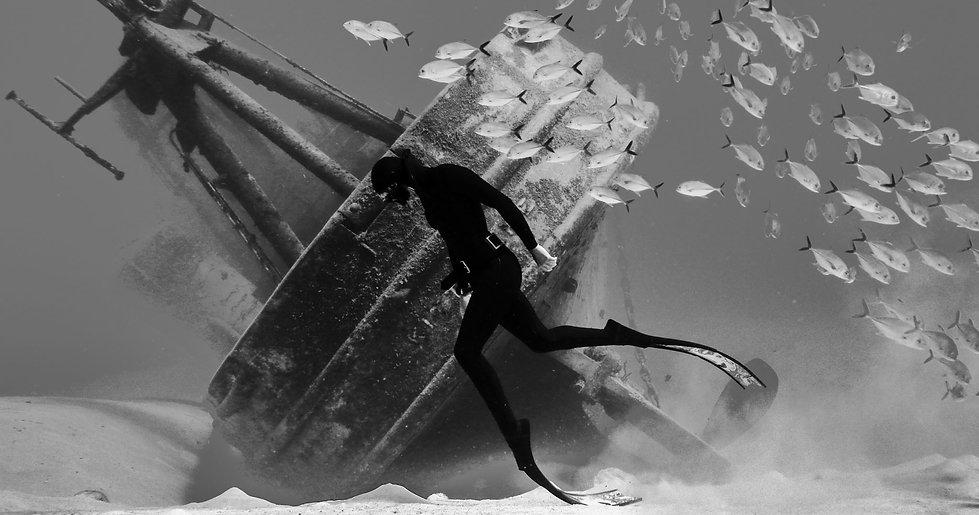 Freediver Talya Davidoff on the wreck of the USS Kittiwake