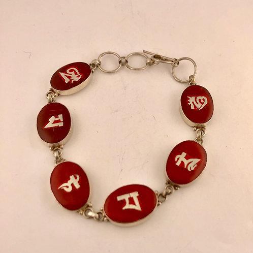 Coral inlaid compassion mantra bracelet