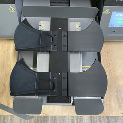 Here is 2 masks with a middle seam loaded on our Middle Seam Mask Platen!