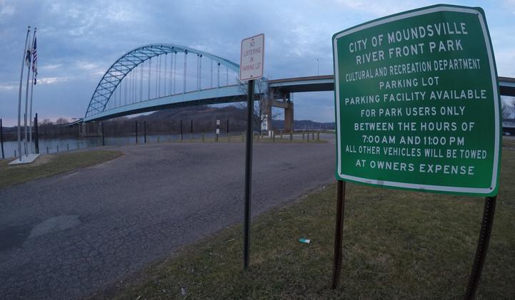 riverfront green sign with bridge.JPG