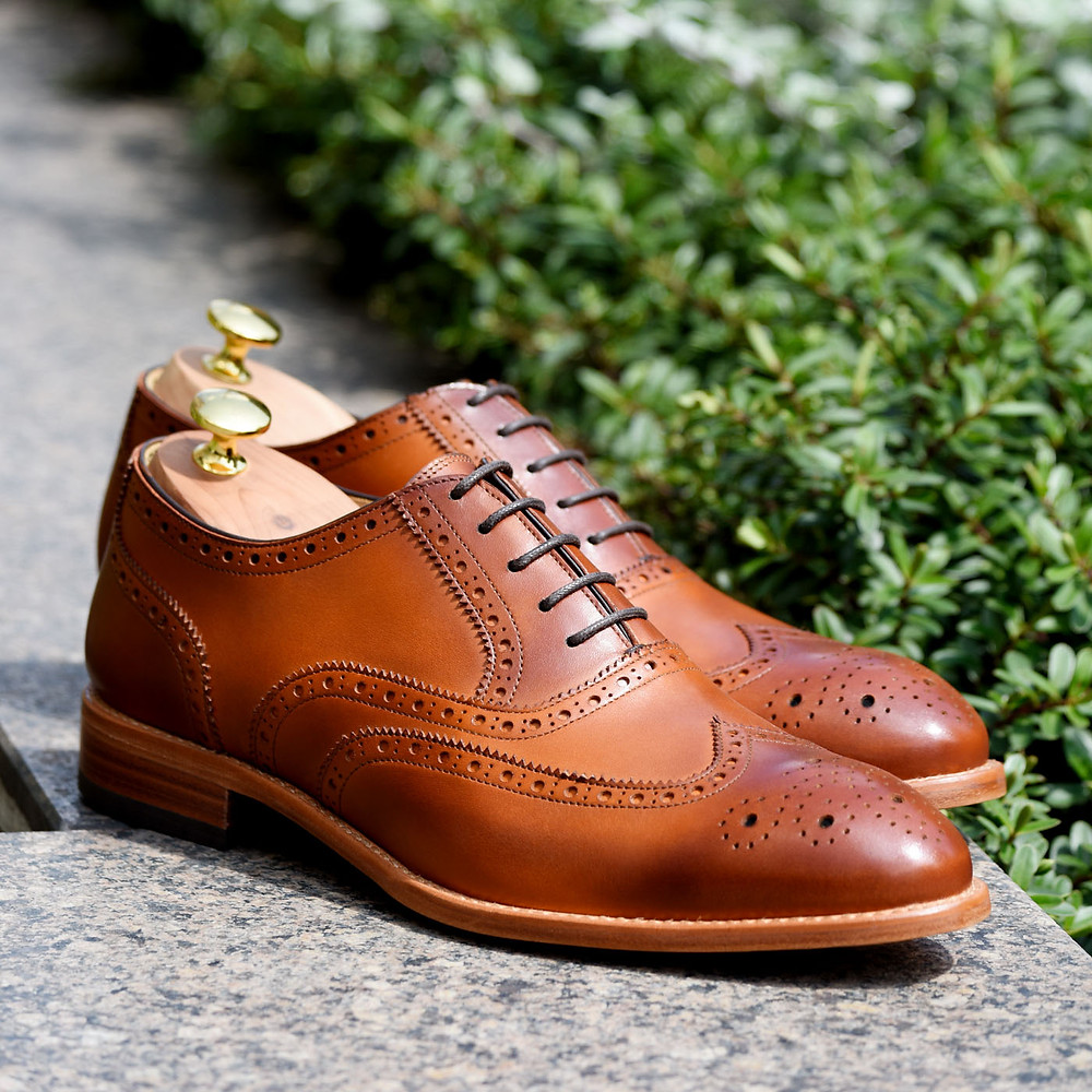 Beckett Simonon ethically made brown shoes with grass in the bacground