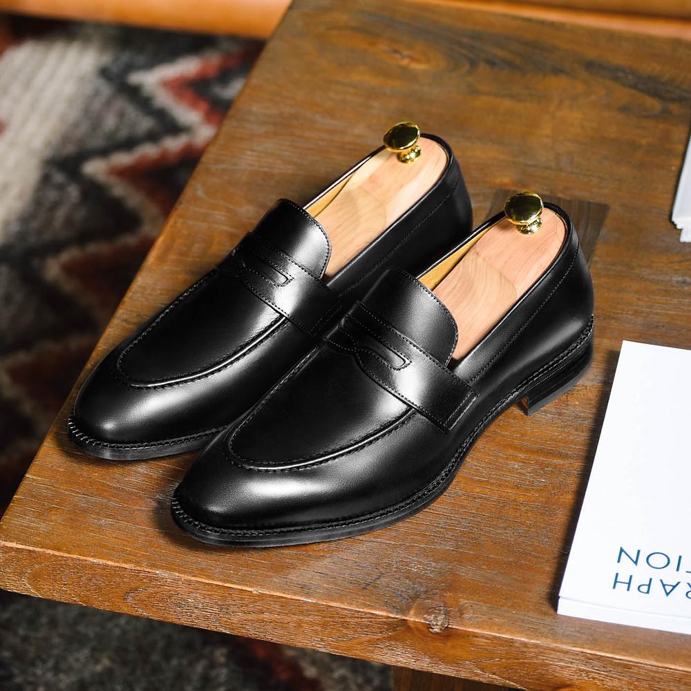 Simonon Beckett ethical bleck dress shoes on a display