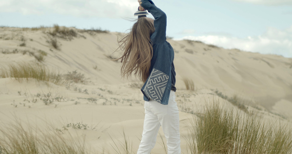 Magda jacket with indigineus embroidery on the pockets and cuffs. By Meüne.