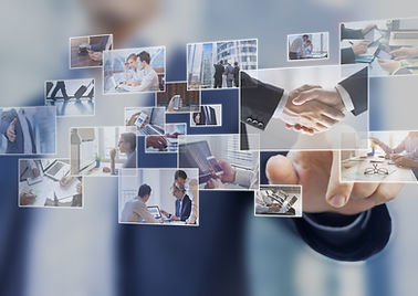 Businessman touching a photo on a digita