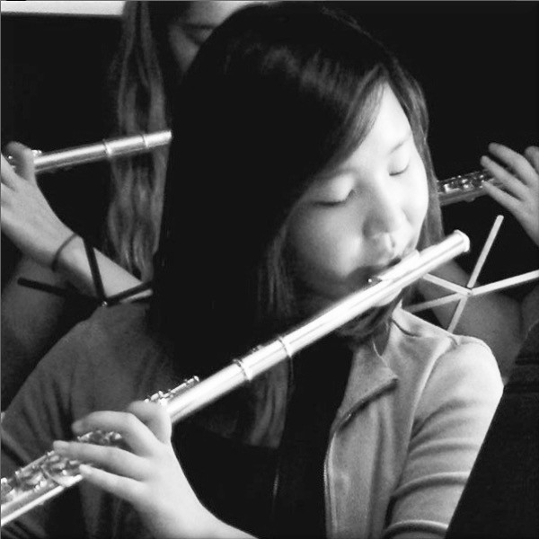 Flute student plays in flute ensemble