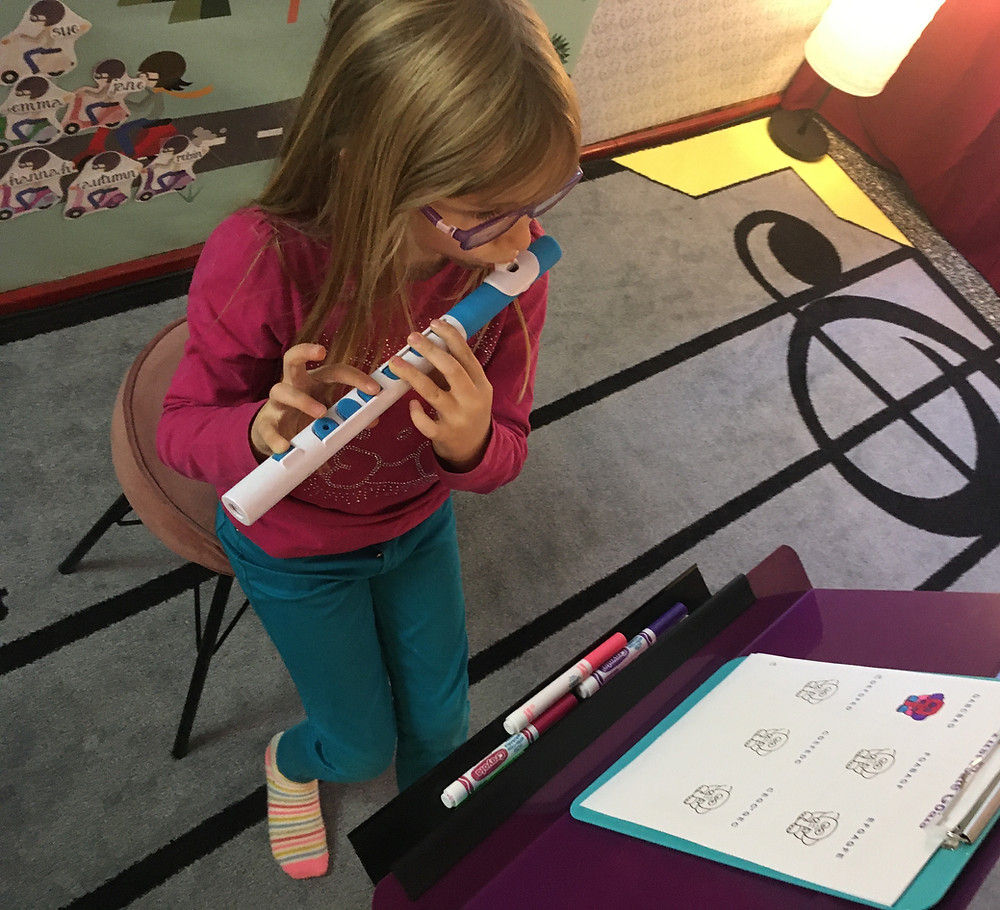 Tiny student plays nuvo Toot flute