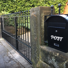 black railings with a post box - Copy.PNG
