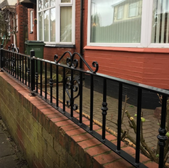 black railings with a decorative pattern - Copy.PNG