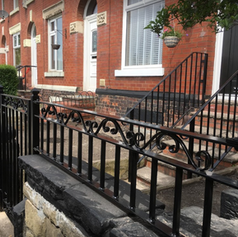 railings and a gate on a property.PNG